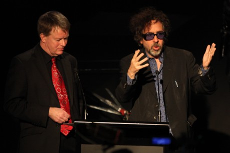 Tim Burton gesticulates as Tony Sweeney, Director of ACMI, preps his next question.